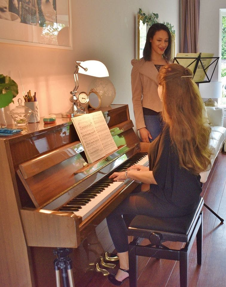 Working at the piano with Frenchesca Marsham, Nala in the Lion King. There is also a grand piano in the studio.